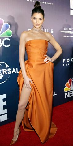 Kendall Jenner headed straight to the Golden Globes after-party, where she wore a strapless burnt orange draped dress that flared out at the waist and featured a thigh-high slit. The finishing touches: a choker, layers of delicate strands by Lorraine Schwartz, and sienna brown pumps.