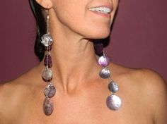 Beautiful purple glazed shell earrings with silver toned chain with a Hypo-allergenic Earring Hook. $28.