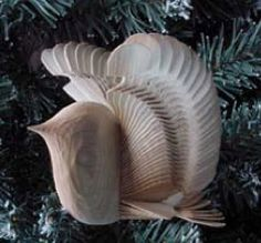 This bird is made from one piece of wood. The technique is called fan-carving. It is the process of riving (splitting) long-fibred wood into individual blades and then turning and interlocking those blades to create a Wooden Bird, Wood Carving, Old World, Fan, Sally, March, British, David, Magazine