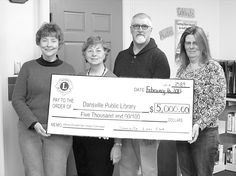Members of the Dansville Lions Club present a ceremonial check to the Dansville Public Library. Pictured are, from left, Library Director Teresa Dearing, Lions Club First Vice President Ann Mahus, Lions Club President Larry McKinney and Lions Club Second Vice President Denise Drum.