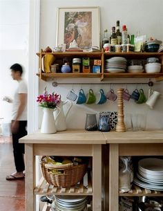 Great idea for coffee cup storage in a small kitchen! Use a rod from IKEA or an old towel rod. I may try this for my pot holders, towels, etc.