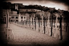 san sebastian old style beach in sepia at the end of the day