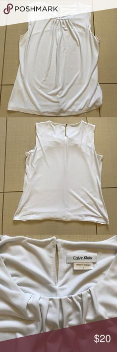 Calvin Klein tank top White tank top. Soft and very comfortable!  Almost new! Calvin Klein Tops Tank Tops