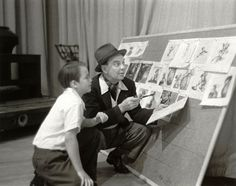 Dickie Jones and Cliff Edwards looking at storyboards for Pinocchio.