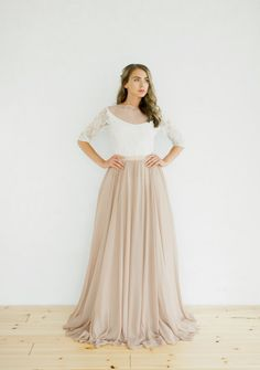 Model: ophelia 001 Description: non-corset wedding dress with a chocolate wool lace and silk skirt; three quarter sleeve open back bodice, fine mesh