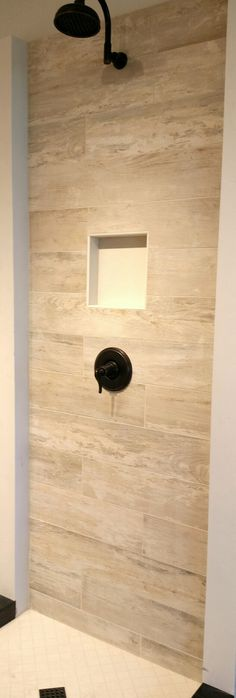 Tile that looks like wood in your shower? Sure! Design yours today! This install features our Club White (https://arizonatile.com/en/products/recycled-material-content/club#utm_sguid=152185,e08b915c-db4e-b781-5bc3-f246575233e3) and Touch Snow (https://arizonatile.com/en/products/recycled-material-content/touch#utm_sguid=152185,e08b915c-db4e-b781-5bc3-f246575233e3) porcelain tiles. See this and more of our new bathroom vignettes in our Anaheim, CA showroom.