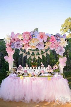 Garden party dessert table with paper flower backdrop | Catchmyparty.com