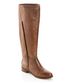 Step into a fairy tale look with these chic leather boots of lore! A distinctly elegant style, these lovely pull-ons feature a low heel and a sleek leg for a flattering look sure to catch the eye.