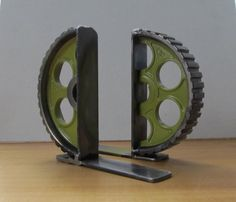 Lime-green Welded Metal Gear-half Bookends. $70.00, via Etsy.
