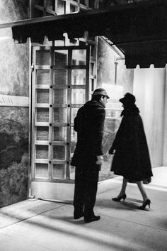 David Hurn  -  USA. NEW YORK.Restaurants New York. The Door Man of one of the most famous restaurants in New York, perhaps in the world, the 'Forum', decorated with painting of Roman figures. It is full for lunch with the millionaire business men of the district. 1962.