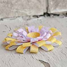 A beautiful paper flower tutorial. Add to gifts, packages, wall decor, or anywhere else you might need a flower.