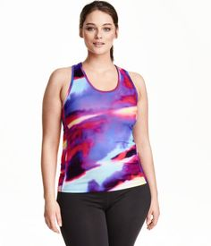 Fitted racerback sports tank top in fast-drying, functional fabric.