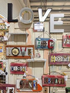 """""""LOVE """" salvaged metal letters. Signs made from vintage hardware,license plates and barn wood. #Vintage Whites Market in Loveland Colorado 2016. #Junk Chic 5280"""