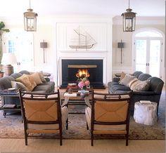 Symmetrical arrangement.  Lanterns, blue velvet sofas, textured arm chairs. Design by Joe Lucas & Parrish Chilcoat.