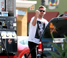Ryan Gosling shook his fist dramatically pumping gas in Studio City, Calif. March 22.