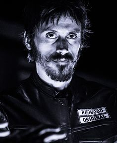 "George ""Ratboy"" Skogstrom - Member of SAMCRO, often taking part in violent activities of the Club.  Later being promoted to Full Patch. (Niko Nicotera).    http://sonsofanarchyonline.com/sons-of-anarchy-cast-members-and-their-characters/"