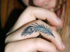 http://slodive.com/wp-content/uploads/2012/08/ring-finger-tattoos/peacock-feather-tattoo.jpg