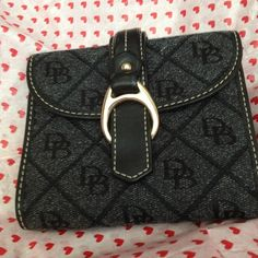 Deal $115 Authentic Dooney & Bourke trade $140 One zipper & 15 pockets in wallet with gold clip))))))))) six credit card  slots & two bill compartments , one lic. Pocket with window & coin compartment. Dooney & Bourke Bags