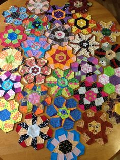 Pieced Hexies: Guest Post and Giveaway! These are by Leslie Claypool from Lafayette, Indiana. http://www.quiltmaker.com/blogs/quiltypleasures/2013/04/pieced-hexies-guest-post-and-giveaway/