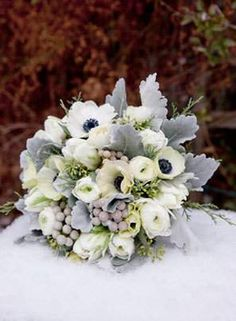 white anemone bouquet with dusty miller, white ranunclus, and brunia berries