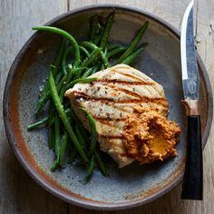 Swordfish with Romesco Sauce - Chef Jonathan Waxman makes his rich, nutty romesco sauce with roasted vegetables, two kinds of nuts and Calabrian chiles. http://www.foodandwine.com/recipes/swordfish-romesco-sauce?xid=NL_DAILY012316SwordfishRomescoSauce