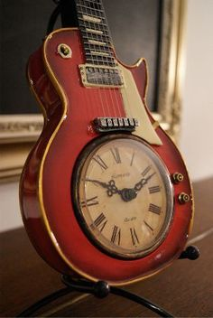 repurposed electric Guitar Clock - for an electric clock! Would be a great #gift for the #musician you love. Just please use a COMMON instrument for JOY - https://www.pinterest.com/DianaDeeOsborne/instruments-for-joy/ - and not a #Vintage guitar, Please Please! DdO:)