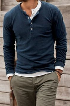 Men in blue long sleeved shirt with buttons at top