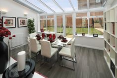 Make the most of the space in your conservatory by adding a dining table and storage solutions, Conservatory Dining Room, Conservatory Extension, Conservatory Ideas, Upvc Windows, Windows And Doors, Dw Shop, Dining Area, Dining Table, House Extensions