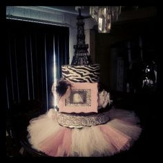 Zebra/Paris diaper cake for Paris themed baby shower. Baby's 4-D picture was placed in the frame.