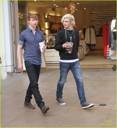 Ross Lynch carries an iced coffee while walking around The Grove with co-stars Calum Worthy, Laura Marano, and Raini Rodriguez