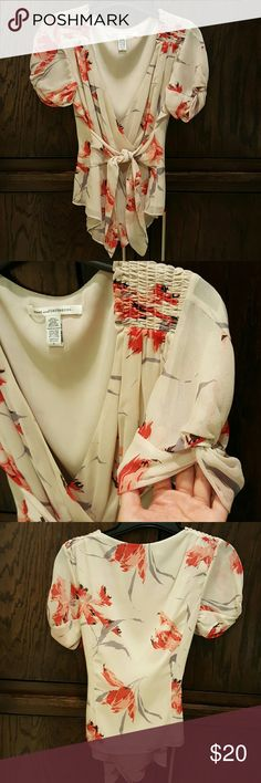 DvF silk wrap top size 2 Exquisite DvF lined silk wrap shirt.  Amazing details on the arms, waist and neck.  Earlier DvF sizing so it runs a small size 2. Excellent used condition.  Too small for me now. Diane von Furstenberg Tops Blouses