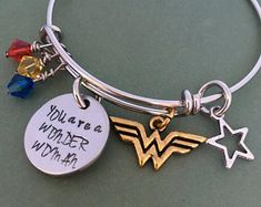 Give the woman wonder in your life a gift of love and remind her of how important she is to you with this hand-made adjustable bracelet, 2 sides of charm, star charm, Wonder Woman charm and three jewels in red, yellow and blue. Bracelet is Wonder Woman Birthday, Wonder Woman Party, Badass Women, Adjustable Bracelet, Hand Stamped, Geek Stuff, Bling, Supergirl, Charmed