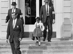 6-yr old Ruby Bridges being escorted by US Deputy Marshals at William Frantz Elementary School. She was the only black child enrolled in the school.