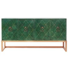 1940's 4 Door commode model TP18 in hand-tooled leather with brass hardware & bleached mahogany base by Tommi Parzinger for Charak Modern #credenza #furniture