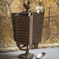 How neat is this utensil holder? Made from rusted cheese graters, it's sure to get the conversation going! Metal Grater Utensil Holder x x Kitchen Utensil Holder, Kitchen Utensils, Utensil Organizer, Cutlery Storage, Serving Utensils, Kitchen Canisters, Antique Farmhouse, Farmhouse Decor, Farmhouse Style