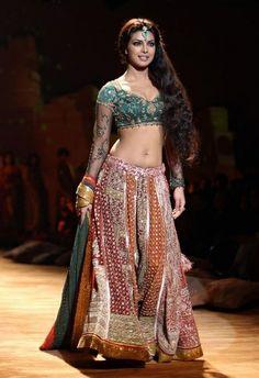 Prinyanka Chopra in a green and orange Ritu Kumar lengha for HDIL Indian Couture Week.