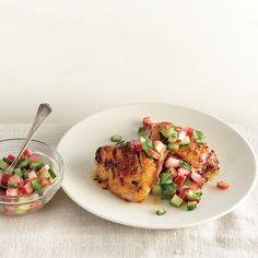 Score the chicken thighs to         deliver more spice and flavor to the meat         and encourage quicker cooking.