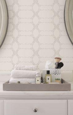 Modern, geometric wallpaper in bathroom