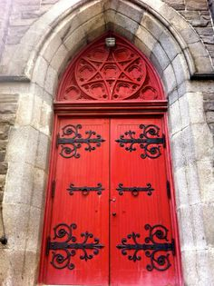 Red doors with black wrought iron
