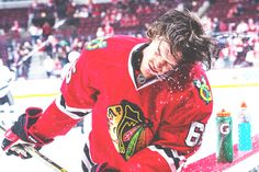 Actually impossible to imagine him without a Hawks sweater on....