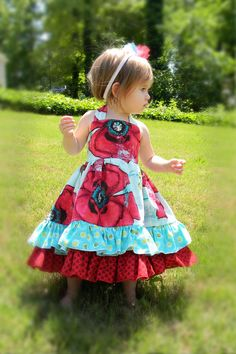 Our Pick A Poppy Ruffle Back Dress is a real SHOW STOPPER. Dress your little girl in this extra special dress and she will surely turn heads everywhere she goes. Great for that special occasion or just a mommie daughter day out on the town. Dress is super full and ties in a pretty knot in the around the neck. Dress has elastic back for a custom fit. Has double ruffles in the front and tons of ruffles down the back.