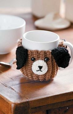 Free crochet dog patterns are fun, simple projects to give your favorite dog a warm sweater, vest or blanket. Granny square vests and blankets are great ways to use up scrap yarns and are colorful and easy to crochet. Dog Themed Crafts, Dog Crafts, Easy Diy Crafts, Crochet Kitchen, Crochet Home, Free Crochet, Free Knitting, Crochet Coffee Cozy, Coffee Sleeve