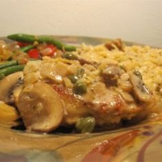 Romantic Chicken with Artichokes and ... Recipe - Chicken is browned and simmered with marinated artichoke hearts, mushrooms, white wine and capers. A simple, savory aromatic treat.