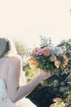Photography: http://katieslaterphotography.com   Floral design: http://blazingstarfarm.com   Read More: https://www.stylemepretty.com/2014/06/09/diy-wedding-block-island-watercolored-gown/