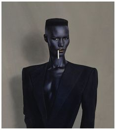 "In 1980, Jones adapted the emerging New Wave music style and adopted a stern, austere look, created in partnership with stylist Jean-Paul Goude.[9] She would also exemplify the so-called ""flat top"" hairstyle in many of her concerts in the 1980s, which would become very popular, especially amongst black men."