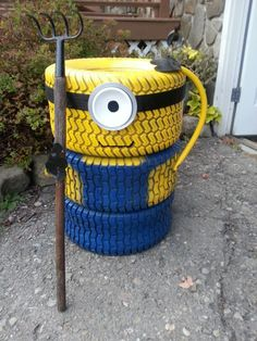 Yard decor on pinterest lawn mower tires minions and garden hose