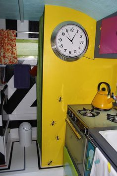 Living in 60 square feet: kitchen and clock. I love the giant ants!
