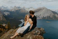 Gorgeous mountain engagement photos in Banff National Park shot by Alberta wedding and Elopement Photographer Havilah Heger. Banff Engagement Photos on top of a mountain | Romantic Hiking Adventurous Engagement Photos | Adventure Mountain Weddings | Rue De Seine Wedding Dress | Boho Wedding Style Mountain Engagement Photos, Engagement Couple, Engagement Session, Banff National Park, National Parks, Mountain Weddings, Engagement Inspiration, Couple Shoot, Boho Wedding Dress
