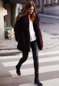 Great faux fur jacket. Loose hair and plain top make the look minimal. Leather skinnies , and Chelsea boots give it a great finish.