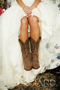 Cowboy boots with wedding dress, exactly what im wearing. I think I'm gonna ride my horse during the wedding reception